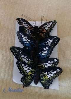 Mariposas de plumas varios colores